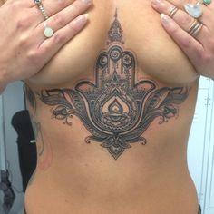 sternum Hamsa tattoo