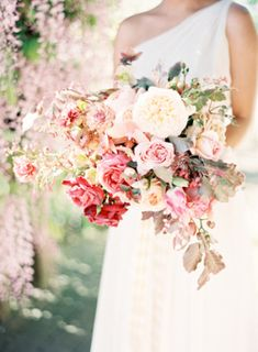 Gorgeous garden-bouquet in shades of ivory, blush, and coral. #wedding #flowers