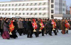 North Koreans spontaneously bring flowers to the statue of The Eternal President Kim Il Sung, because they were told to.