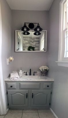 White Farmhouse Bathroom Wall Cabinetinterested in transforming your bathroom into a relaxing manner in imitation of upda Bathroom Accent Wall, Bathroom Wall Cabinets, Bathroom Accents, White Bathroom Accessories, Gray And White Bathroom, White Bathroom Tiles, Rustic Bathroom Decor, Rustic Bathrooms, Modern Bathroom