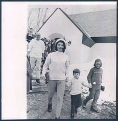 Caroline, on the stairs, is behind Jackie, who is with John Jr and Courtney Kennedy, April 18, 1965.