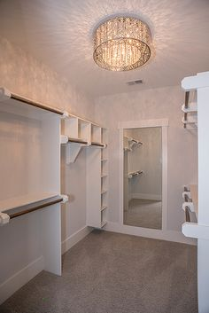 walk in closet - mirror / light - would need at least 3x as much hanging space.