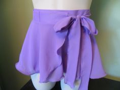 This light and flirty wrap-around ballet skirt will finish off any leotard in style. Pair it with some shorts, over a bathing suit for a cute cover
