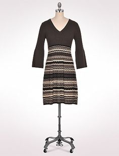 YES -- for the full bust & fuller belly, too, I promise!   I bought this & am very pleased with the HOUR GLASS and unexpected SLIMMING look it gives.   LIGHT WEIGHT so not too hot at work.   V-neck great look for full busts!       Textured Zigzag Sweater Dress   Dressbarn  $60