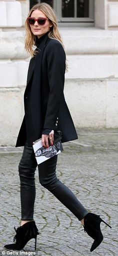 Leggy lady! Slipping her long legs into a pair of black leather trousers, the socialite co...