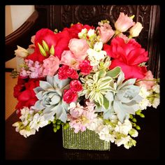"""Anniversary flowers!  Featuring gray succulents, reflexed pink roses & others in a lime green """"bling"""" wrapped vase."""
