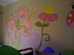 hand painted mural baby girls room, pic 1. butterfly and flower. entire wall 4 hours