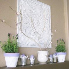 Lisa (lisaferncreek.blogspot.com) stuck with two colors, white and lavender, on her mantel to create a pretty spring look. The pitcher centered on the mantel holds twigs from her backyard. She hot-glued lavender paper butterflies to the pitcher. She painted faux eggs purple and set them in a nest of crinkly white paper inside glass votives. To finish the display, she painted the tops of clay pots lavender./