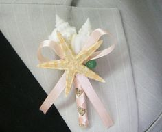 Shell Boutonniere  Starfish with semiprecious stones green aventurin and coral ribbon  This bridal corsage, wrist has a rustic charm about it and is sure to please any bride.  Corsage for a beach. Seashells with sea fan .  Boutonniere size is as listed: Height: Approximately 3 inches tall Diameter: Approximately 2 inches at the widest .   If you have a specific vision and would like to change the size, color on ribbon of this boutonniere, please contact me for a personalized quote.