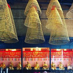 #chinese incense coils hang throughout kun iam #temple in #macau. this temple is very large with room after room each decorated differently and featuring different buddhas. #buddha #buddhism #spiritual #spirituality #interiordesign #design #interior #architecture #travel #travelgram #traveling #travelphotography #asia