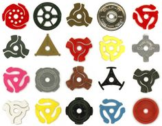 45 record adapters...Oh, yeah...can't forget these...there's a couple there i don't recognize