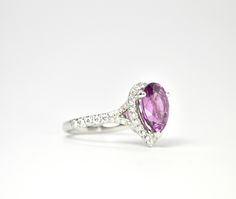 Natural Purple Sapphire engagement ring. For sale at Redford Jewelers in Salt Lake City.  4.26ct pear shaped purple sapphire with diamond halo and band.