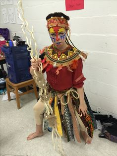 RAfiki skirt uses fabric strips from all the other animals in the show. Collar and hat made from old flexible straw hat that the kids covered with beads, feathers, cowrie shells, etc. (understudy)