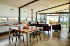 The Contemporary Weekender by Twinkle & Whistle (for Scoop Magazine) - Living Room/Dining: polished concrete floors, steel beams, timber and white cabinetry - Craig Steere Architects