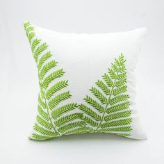 Contemporary pillow cover made from cream linen and embroidered with fresh green fern leaves. This pillow cover has hidden zipper and it is available in