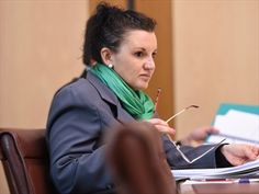 OUTSPOKEN Palmer United Party senator Jacqui Lambie has rejected a Liberal MP's invitation to visit a mosque because she is Australian and a Catholic.