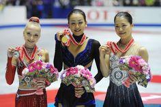 TOKYO, JAPAN - NOVEMBER 09: (L-R) Silver medalist Elena Radionova of Russia and Gold medalist Mao Asada of Japan with Bronze medalist Akiko ...