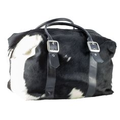 This beautiful cowhide overnight / weekend bag has quality suede lining and Italian leather handles and is Australian made. There is one of these cowhide bags l