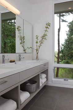 15 Examples of Bathroom Vanities That Have Open Shelving // The large open shelves in this vanity are large enough to house baskets of toiletries as well as multiple fluffy towels. Open Bathroom Vanity, Best Bathroom Vanities, Bathroom Vanity Cabinets, Bathroom Shelves, Bathroom Storage, Contemporary Bathrooms, Modern Bathroom, Small Bathroom, White Bathroom