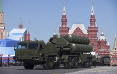 Russian S-400 air defense missile systems make their way through Red Square during a rehearsal for the Victory Day military parade in Moscow. - Russia sent an advanced missile system to Syria on Wednesday to protect its jets operating there and pledged its air force would keep flying missions near Turkish air space, ...