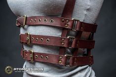 Woman leather harness of mahogany leather in steampunk style. Excellent sexual addition to woman clothes. Perfectly matches dress, blouse, shirt or undervest, each time making your attire look anew. Specification: - Quality genuine cowhide. - Quality Italian metal accessories in brass