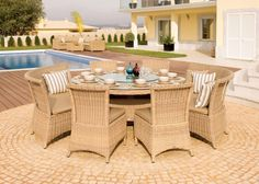 Outdoor / Garden Furniture - Auckland 170cm Round Dining Table with Four Dining Chairs and Two Dining Benches in Light Bonano. Fabric Shown: Durban Beige. Frame Shown: Light Bonano £3,015