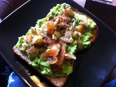 Healthy snacking! Wholewheat toast topped with mashed avocado and pico de gallo.