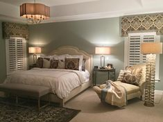 A striking curlicue floor lamp brings movement and dimension to the cool neutral and blue color scheme of this bedroom.