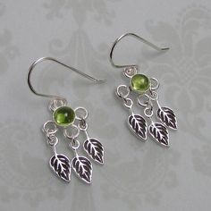 Peridot Leaf Chandelier Earrings handcrafted from sterling silver — Kryzia Kreations: Nature, mythic, vintage style artisan jewelry  $100.00