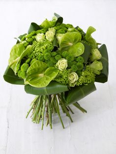 All green bouquet of anthurium, roses and mums with folded leaves