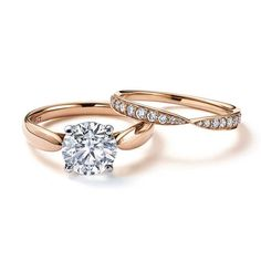Tiffany Harmony solitaire diamond engagement ring in rose gold, with a matching rose gold wedding band with diamonds.