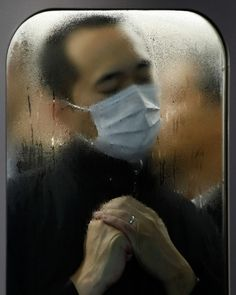 MICHAEL WOLF, TOKYO COMPRESSION 75 2012: portraits of citizens shot through the windows in the packed subways of tokyo.