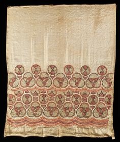 This object is from a collection of sample embroideries, which was originally owned by Morris de Camp Crawford, editor of Women's Wear Daily, who collected objects which told the story of fashion and fabric history