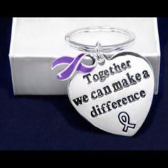 """Pancreatic Cancer Awareness Key Chain These purple ribbon awareness key chains are sterling silver plated and have the words """"Together We Can Make a Difference"""" along with a purple ribbon charm. The heart charms are approximately 1 1/2 inches by 1 1/2 inches. Each key chain comes in a gift box with a cotton insert. Jewelry"""