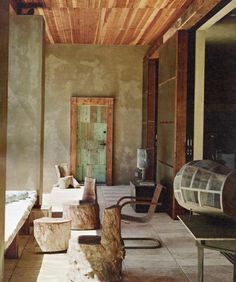 Daniel Hale photo. Terrace overlooking pool. I love the door and the furniture made from pieces of trees.