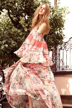 Love the soft print with the peachy/rose color... Roberto Cavalli always makes it interesting