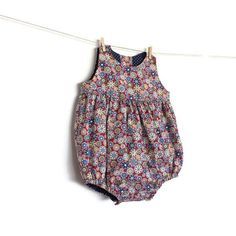Baby Romper Sewing Pattern – PDF – Instant download This lovely romper has 4 different variations, all of them super cute! You can make it gathered, or with pleats and with or without peter pan collar! It can be worn with a blouse for a winter version, or you can use only the romper on a hot summer day. The pattern was thought to offer you not only a lovely garment, but also a profissional and neat one. It is fully lined so all the seams are hidden inside. → check shop announcement to get…