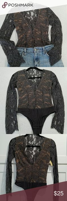 Lace Bodysuit Top This eye catching bodysuit gives you a shapely silhouette that stays tucked in. Dressed up with stunning lace and a plummeting neckline, it's an alluring option for a night out.  •Low V neckline •Bottom snaps •Side zipper Boutique Tops