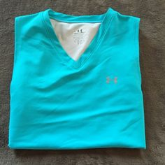 Under Armour workout tank V neck workout tank...semi see through mesh on back..other than a couple little spots of piling, see last pic, in good condition! Under Armour Tops Tank Tops