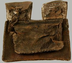 Purse Date: 1400s Culture: French Medium: Tooled leather Dimensions: Overall: 6 11/16 x 7 7/16 x 3/4 in. (17 x 18.9 x 1.9 cm)