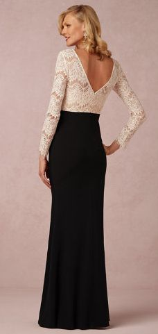 We love this long-sleeved, lace bodice, with sleek black skirting for a mother of the bride dress! How comfortable and elegant this would be on your mother. She's sure to feel honored and beautiful in this dress! Stunning. #motherofthebridedress