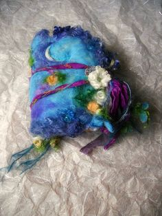 a magical rose garden in moonlight...    softly needle felted from hand dyed wool, silk and wool curly locks. ~ 110 pages of handmade papers, some