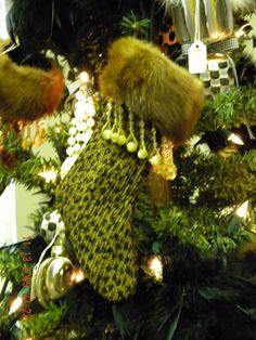 Fun stocking ornaments made from scrap upholstery fabric, scrap mink fur and bead trim from Hobby Lobby.  On some I used boa feathers  and stuffed with tissue paper to make fun