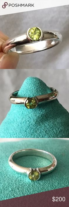 Tiffany and Company Green emerald Stacking Ring Tiffany and Company Green Stone Stacking Ring.      Ring in excellent condition no visible scratches.                 see photos. Tiffany & Co. Jewelry Rings