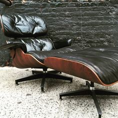 Rare Early Rosewood Eames Lounge Chair and Ottoman  by JoShlamiel