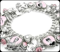 This amazing Audrey Hepburn charm bracelet includes 5 images of some of her iconic films, including her signature set into stunning sterling silver heart frames, topped with freshwater pearls, rose Sw