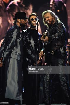 Maurice Gibb, Robin Gibb and Barry Gibb of the Bee Gees perform at the BG2K Millennium Concert at the National Car Rental Center On December 31, 1999 in Sunrise, Florida.
