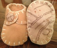 Harry Potter baby Marauder's Map 'I solemnly swear' 'Mischief Managed' yellow booties newborn to 3 months - handmade wool felt with buttons. $15.58, via Etsy.
