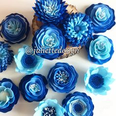 A personal favourite from my Etsy shop https://www.etsy.com/listing/531641305/set-of-9-blue-flowers-felt-flowers-blue