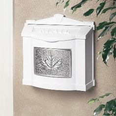 Gaines Mailboxes: White Wall Mailbox with Satin Nickel Leaf Emblem by Gaines Manufacturing. $186.00. Gaines Mailboxes: White Wall Mailbox with Satin Nickel Leaf Emblem
